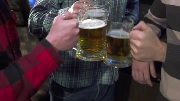 Men drink lager near the bar counter
