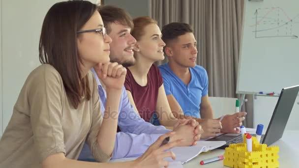 Creative team watches some presentation