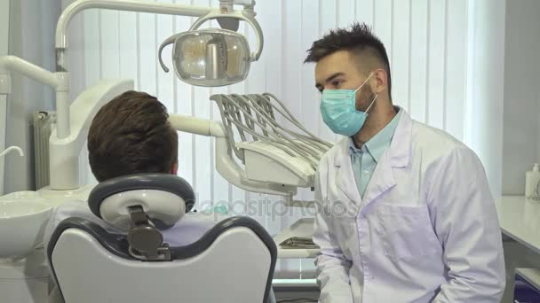 Dentist begins check up at the office