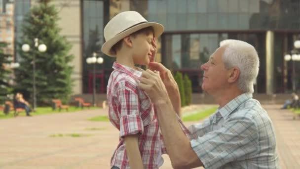 Senior man hugs his grandson