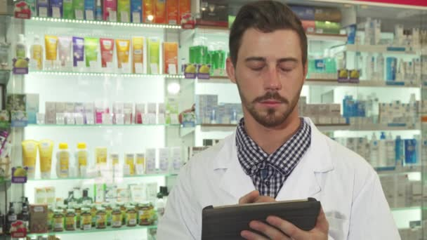 Druggist examine drugs inventory with digital tablet
