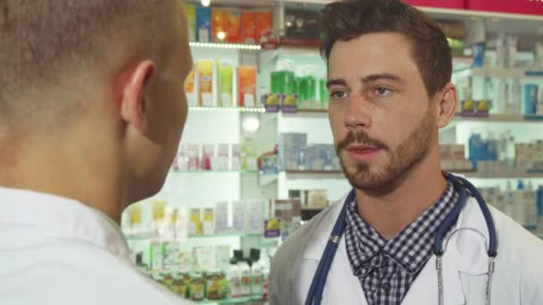 Doctor talking to patient at drugstore