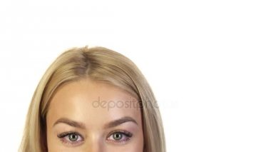 The blonde looks at the camera and then looks up