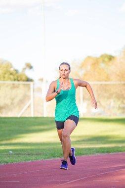 Fit female athlete spring