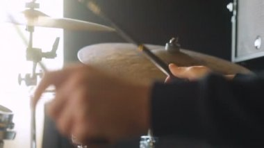 Man playing on drums