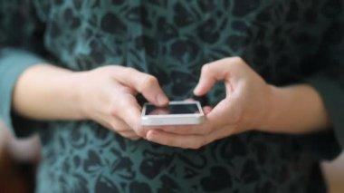 Pregnant woman using smart phone
