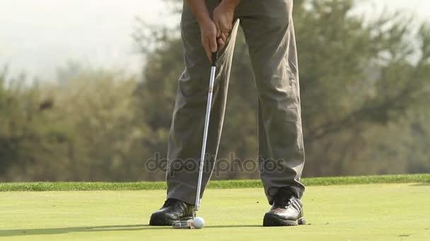 Man putting golf