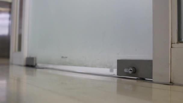 Feet Walking Through Glass Door Stock Video Propalta 160501922