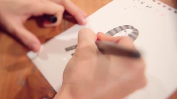 ruce, kreslení karikatury na papíře