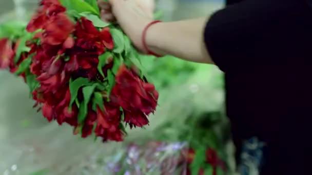 florist making bouquet