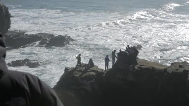 People on seaside rock