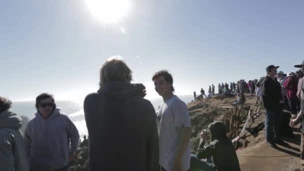 People around ocean cliff