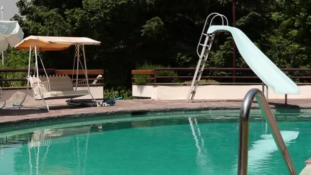 Pool with slide and swing