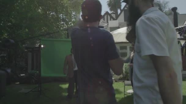 Film crew shooting man
