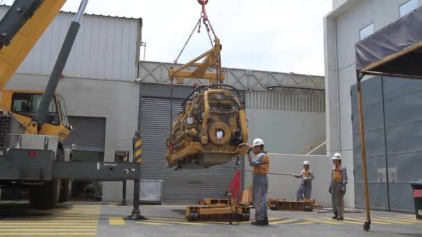 technicians working with industrial equipment