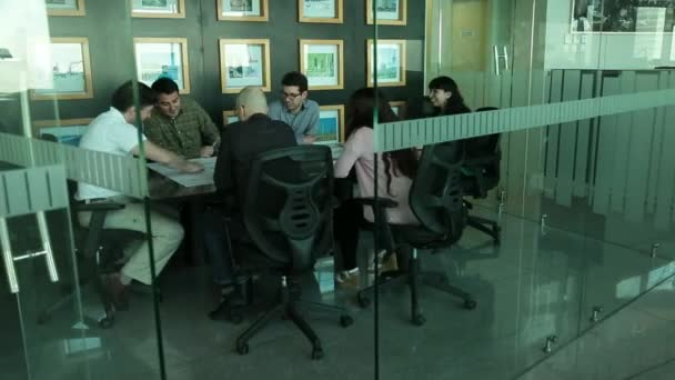 office employees laughing during a meeting