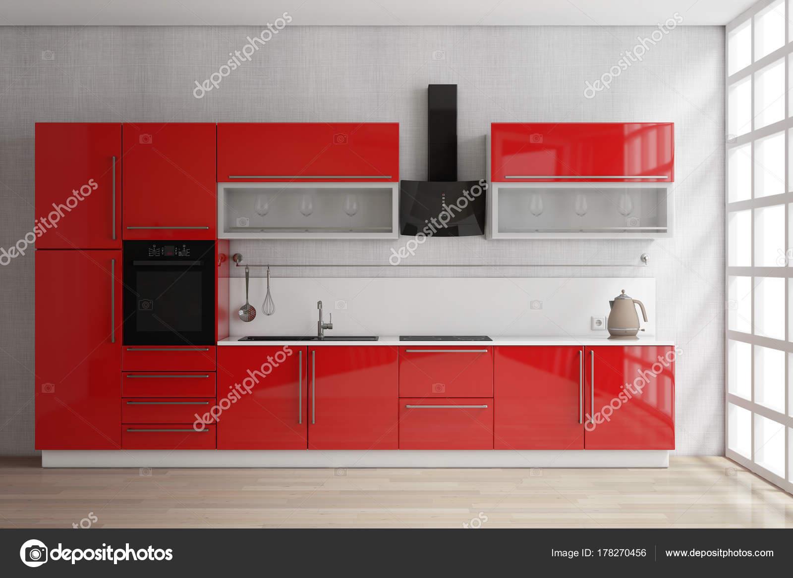 Muebles de cocina rojo con utensilios de cocina junto a la ventana ...