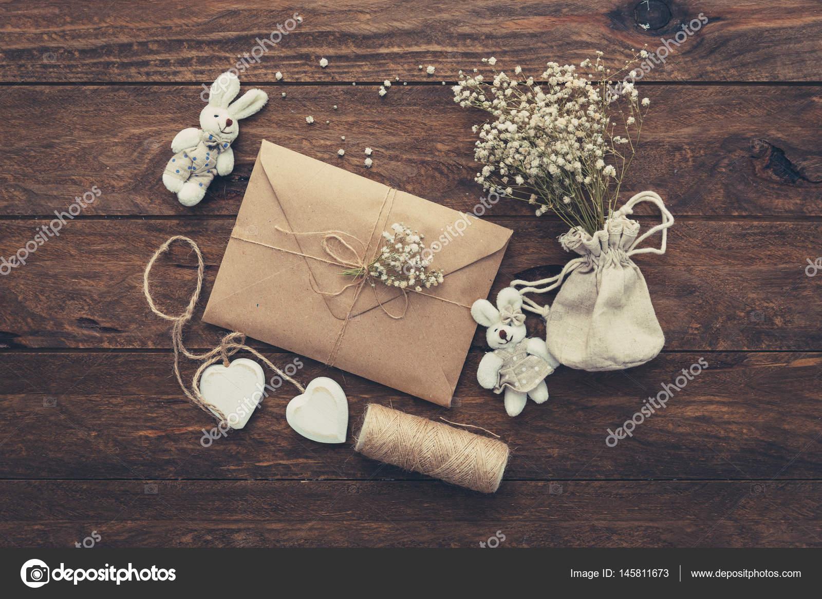 Wedding invitation. Craft envelope with decorations — Stock Photo ...