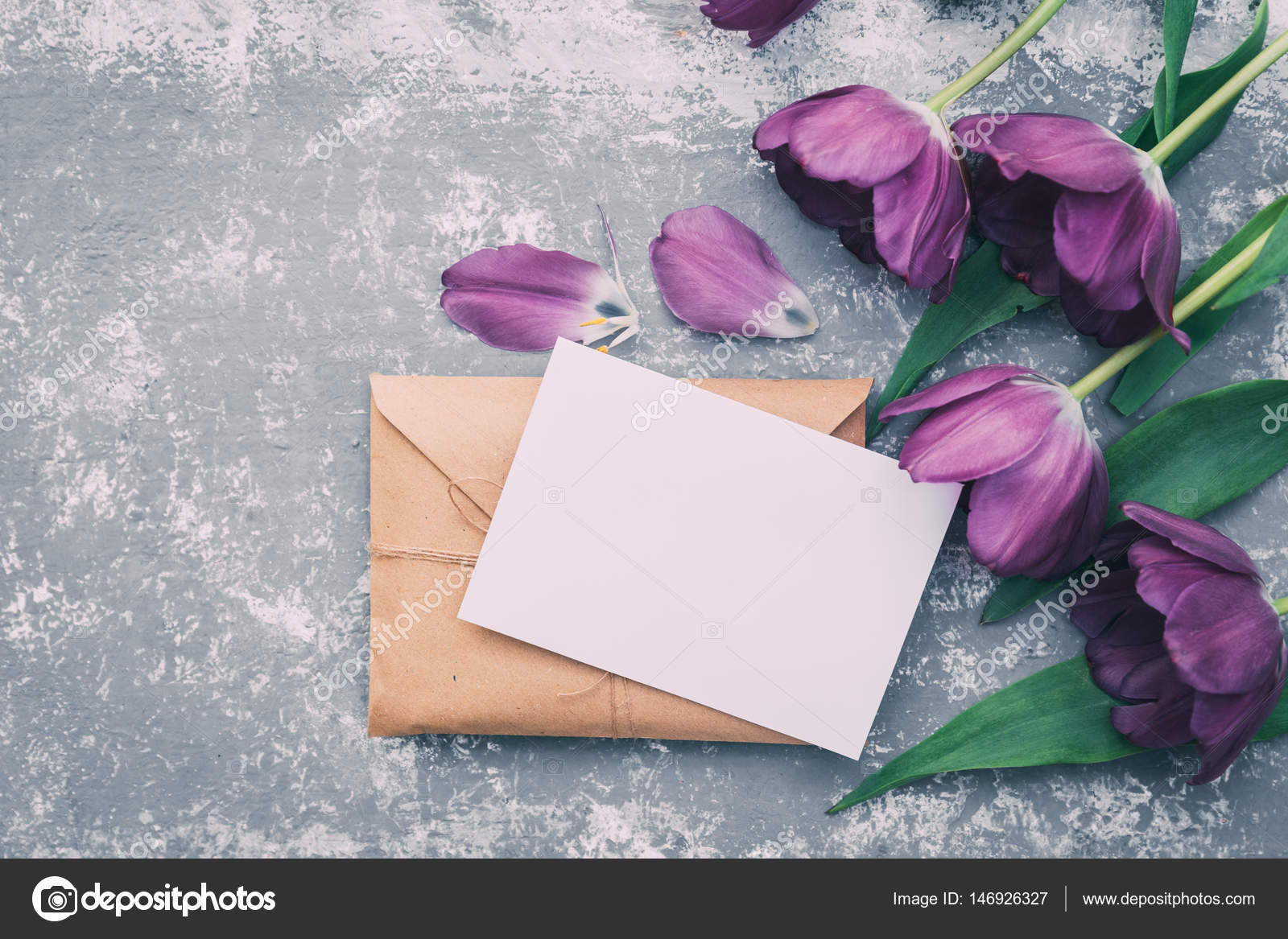 brown paper envelope with empty blank with flowers wedding
