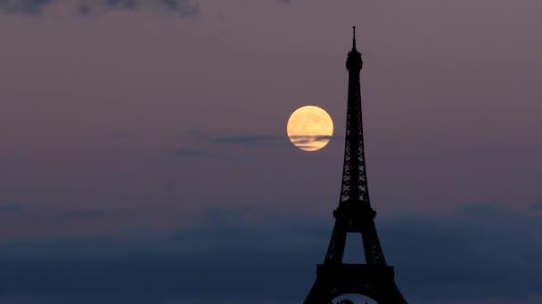 Moon rise behind Eiffel Tower Paris