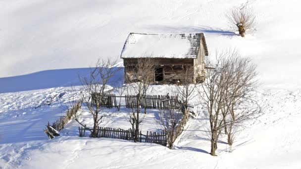 Little wooden traditional rustic household in winter