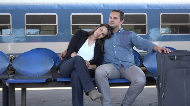 Couple embrace wait in train station, happy travel, new life, smiling
