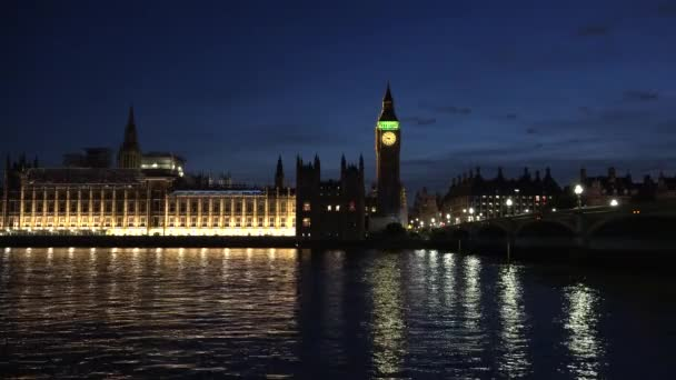 London Parliament (Palace of Westminster), Big Ben clock tower and Westminster Bridge reflected in Thames by night