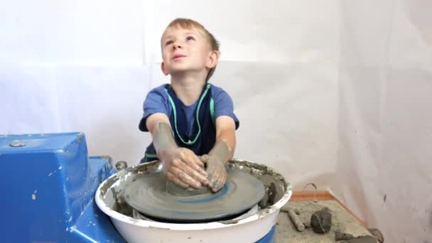 Portrait of happy child modeling clay, art pottery, loving handmade