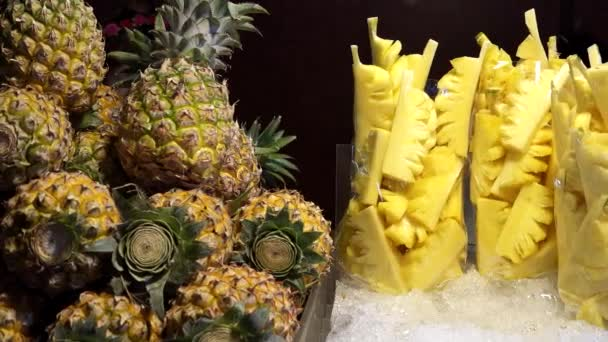 Delicious pineapples slices on ice for sale as street food in Bangkok, Thailand