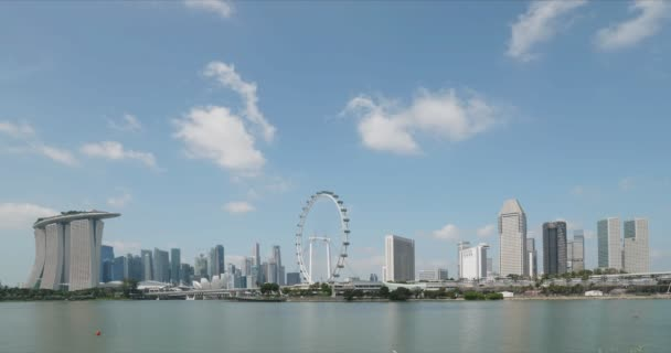 Timelapse of clouds on blue sky over panorama of Singapore