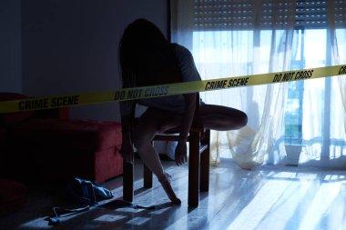 Crime scene imitation. Lifeless woman lying on the chair