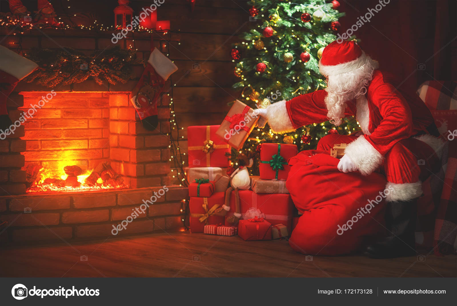 merry christmas santa claus near the fireplace and tree with gi stock photo c evgenyataman 172173128 merry christmas santa claus near the fireplace and tree with gi stock photo c evgenyataman 172173128
