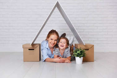 Concept of housing, mortgage and relocation family mother and child  with roof and boxes near wal stock vector