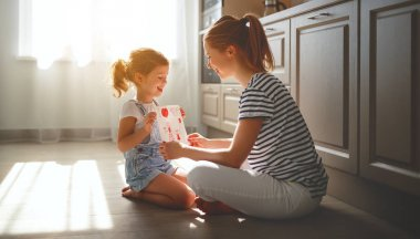 happy mother's day! child daughter congratulates her mother and