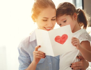 Happy mother's day! Child daughter congratulates moms and gives