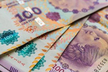 Close up of Argentine money, 100 pesos bills.