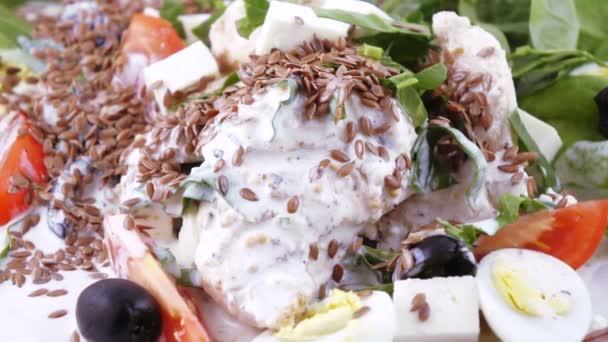 Assorted salad on lettuce leaves