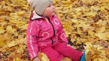 Baby girl with yellow leaves