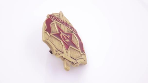 Iron KGB badge on white