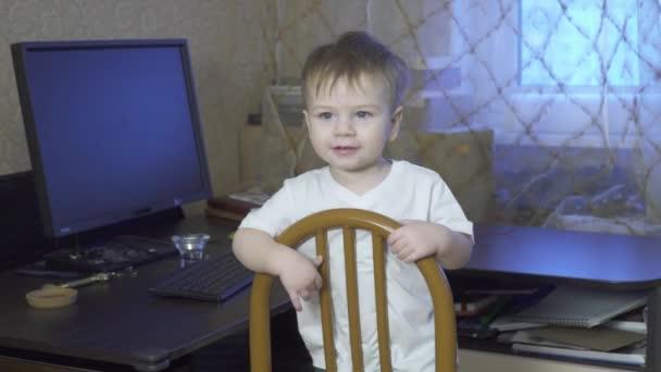 Boy swinging on a chair