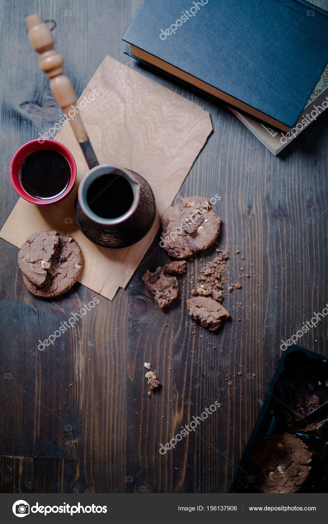 Coffee cup and cookies and coffee maker are on the wooden table coffee cup and cookies and coffee maker are on the wooden table next to the book geotapseo Images