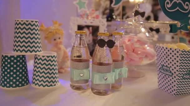 different bottles of juice on the table. Bottled drinks for guests at the party. glass bottles with drinks. Bottles