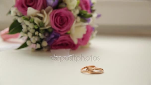 Wedding rings and rose. Wedding jewelry and rings. The Beauty Wedding Ring on a box. Golden wedding rings