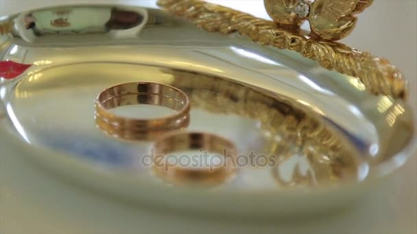 Wedding rings and rose. Jewelry and rings