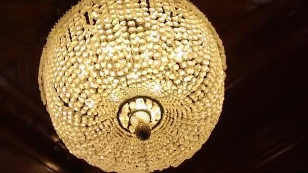 Amazing luxury chandelier on ceiling. The big crystal chandelier.
