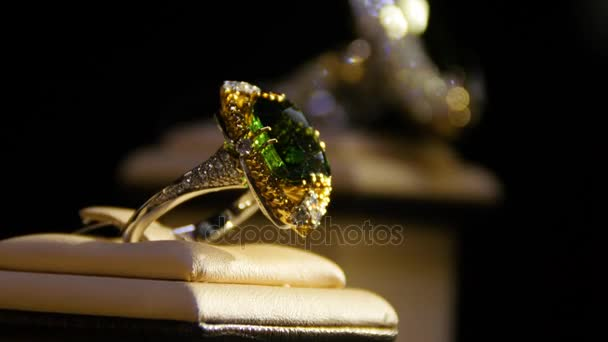 Jewelry with emeralds and diamond. Gemstones. Gold ring with emerald