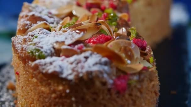 Walnut shavings on cake close up, macro. Delicious dessert cakes. Homemade pastries. Nut cake