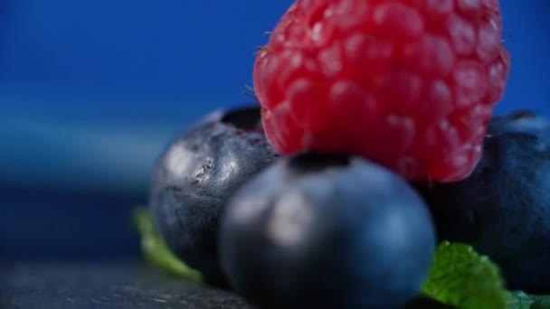 Fresh fruits - blueberry, raspberry. beautifully lined with raspberries and blueberries