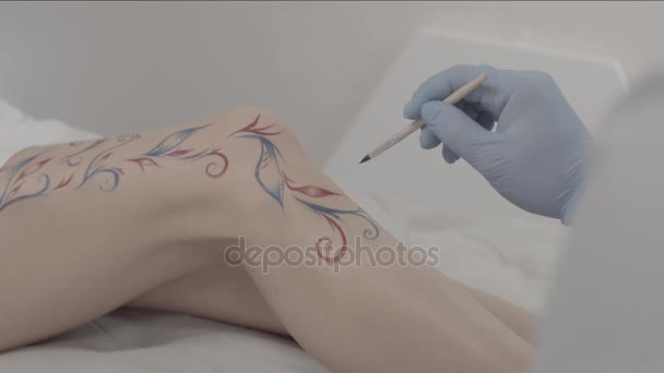 Close Up Of An Artist Hand Drawing Temporary Tattoo On Someone Leg Young Female Body Art Painter Making An Ornament And Decoration On Her Leg Stock Video C Mediawhalestock 160241930