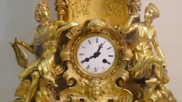 Ancient vintage brass pendulum clock. Vintage gold watch